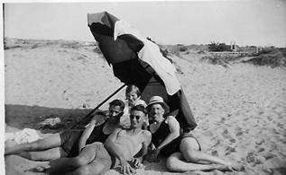This photo shows Albert (left) & Toby (back) with friends at Rinella beach, Malta